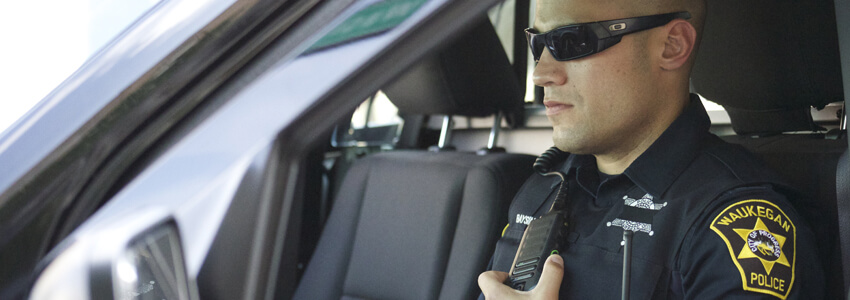 police officer using his radio